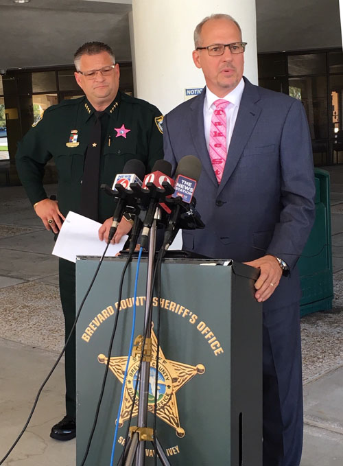 Brevard County Sheriff's Office and Dr. Mark Mullins standing at podium