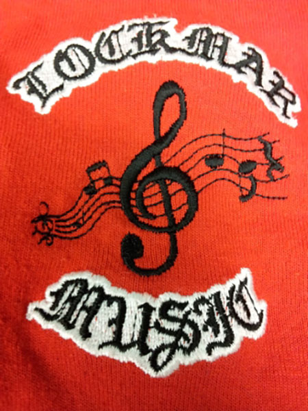 Picture of treble clef with the words Lockmar Music