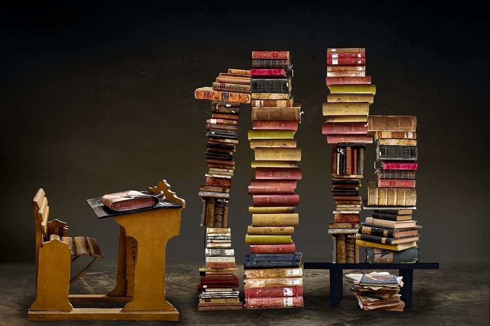 Stack of books with desk